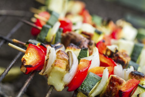 Close up of vegetables and chicken shish kabob